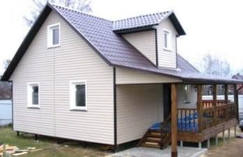 Дом из бруса 7х7,4 с эркером и террасой